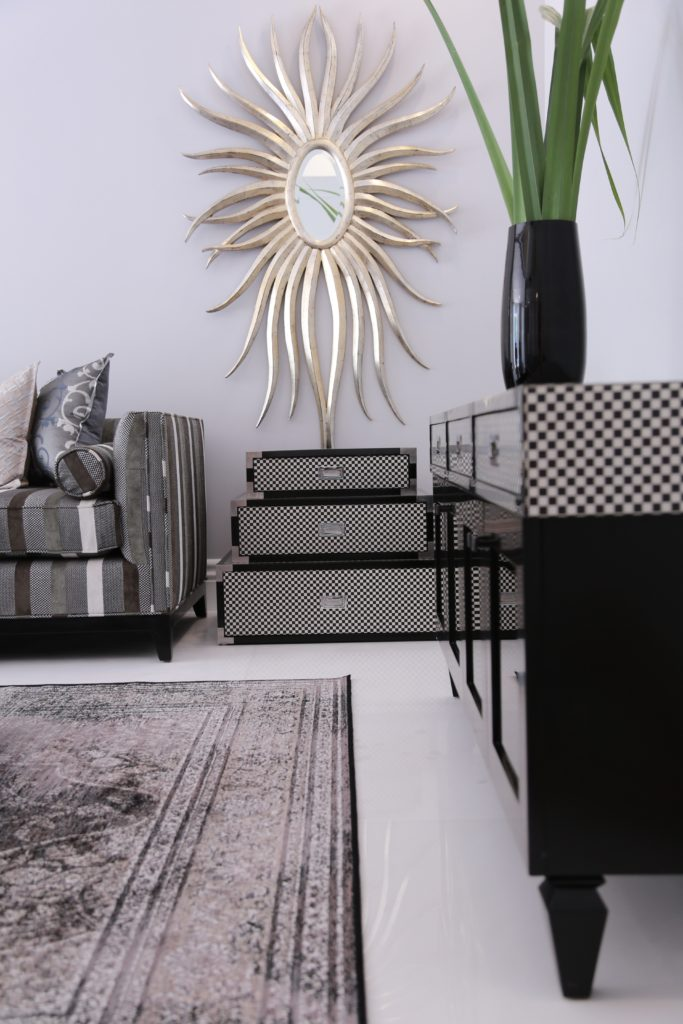 mirror-rugs-blackandwhite-occasionalchairs-black-trunks-tvunit-checkerboard-sugarbakers